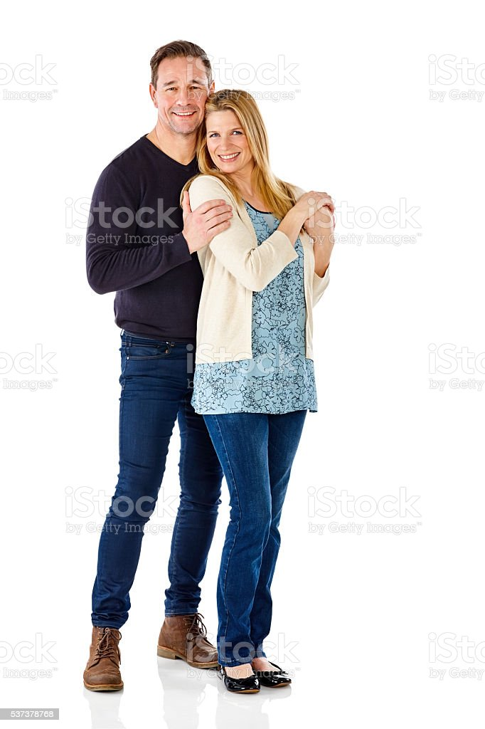 Loving mature couple standing together stock photo