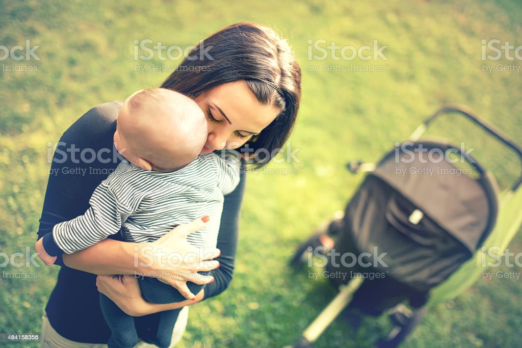 Loving mother hand holding cute sleeping newborn baby child stock photo