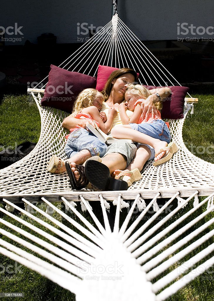 Loving Mother Sleeping with Children on Hammock royalty-free stock photo