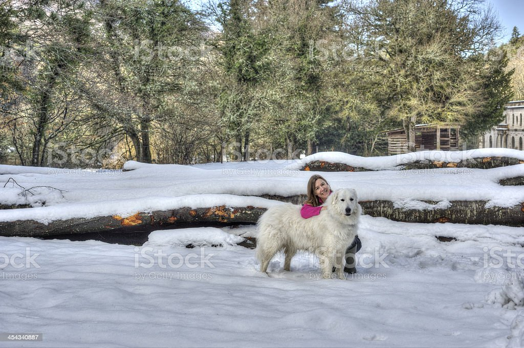 Loving owner with dog in snowy landscape stock photo
