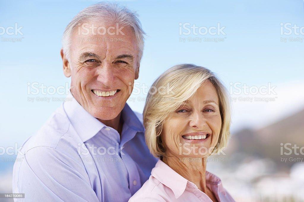 Loving senior couple embracing outdoors royalty-free stock photo