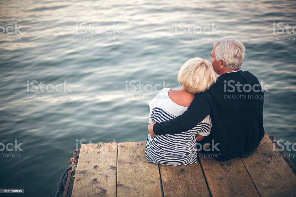 Loving senior couple enjoying the view stock photo