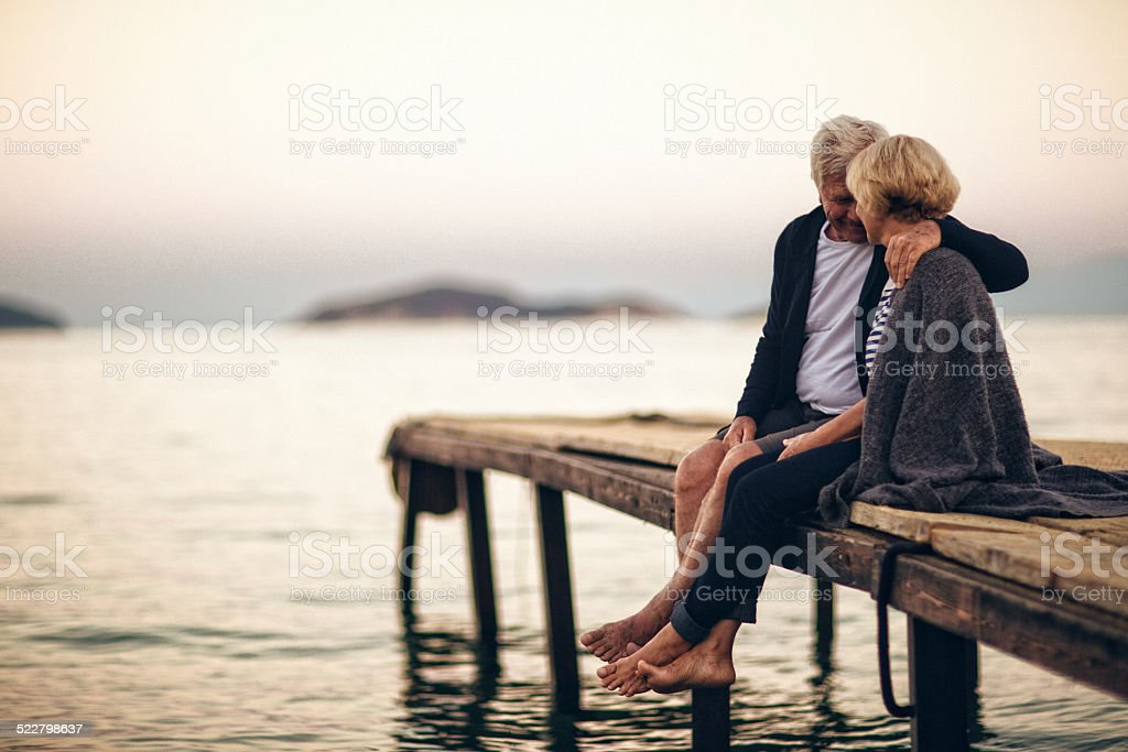 Loving senior couple enjoying their life together stock photo