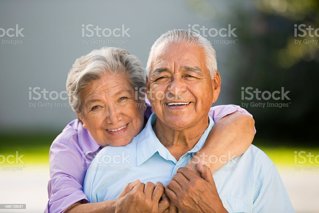 Loving senior couple hugging stock photo