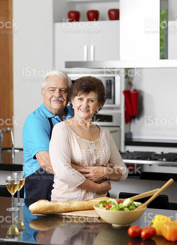 Loving senior couple in the kitchen royalty-free stock photo
