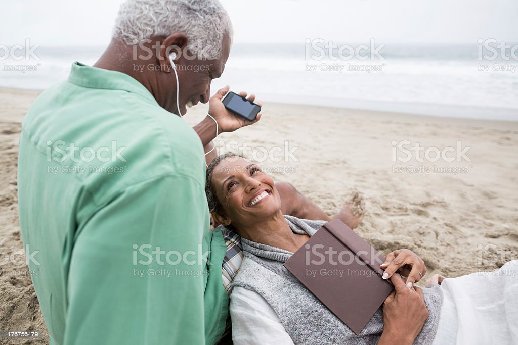 Loving senior couple relaxing on the beach royalty-free stock photo