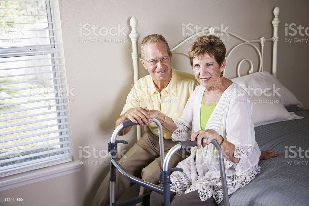 Loving senior couple, with walker stock photo