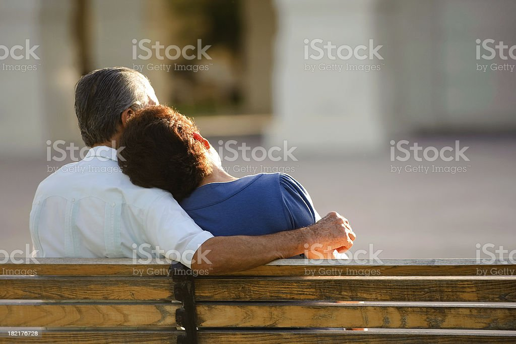 Loving senior sitting together royalty-free stock photo