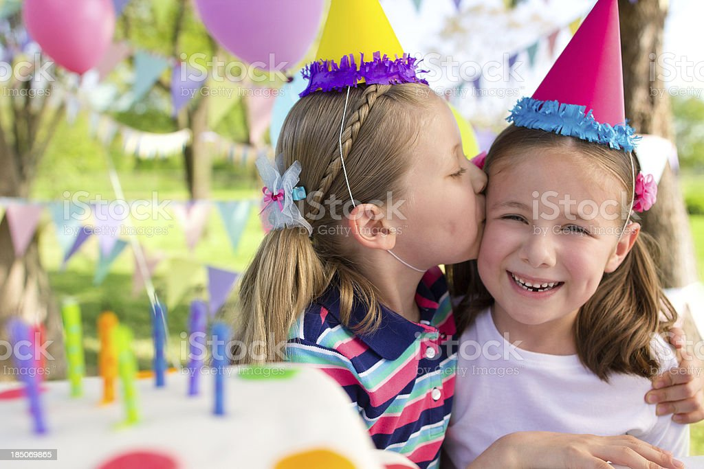 Loving sisters at a birthday party royalty-free stock photo