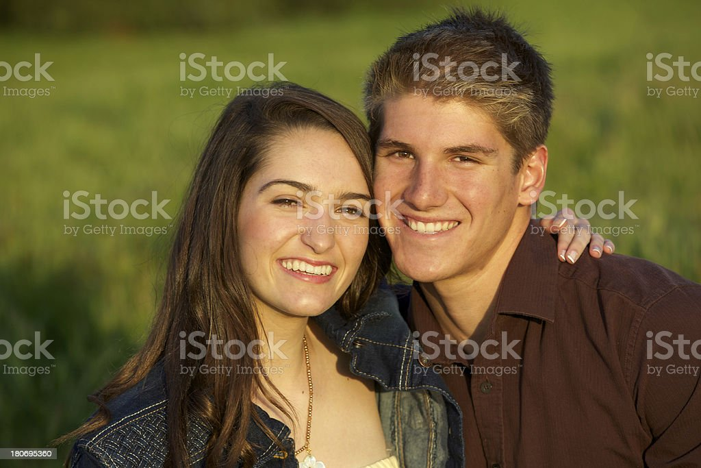 Loving Teenage Couple Portrait in Grassy Meadow royalty-free stock photo