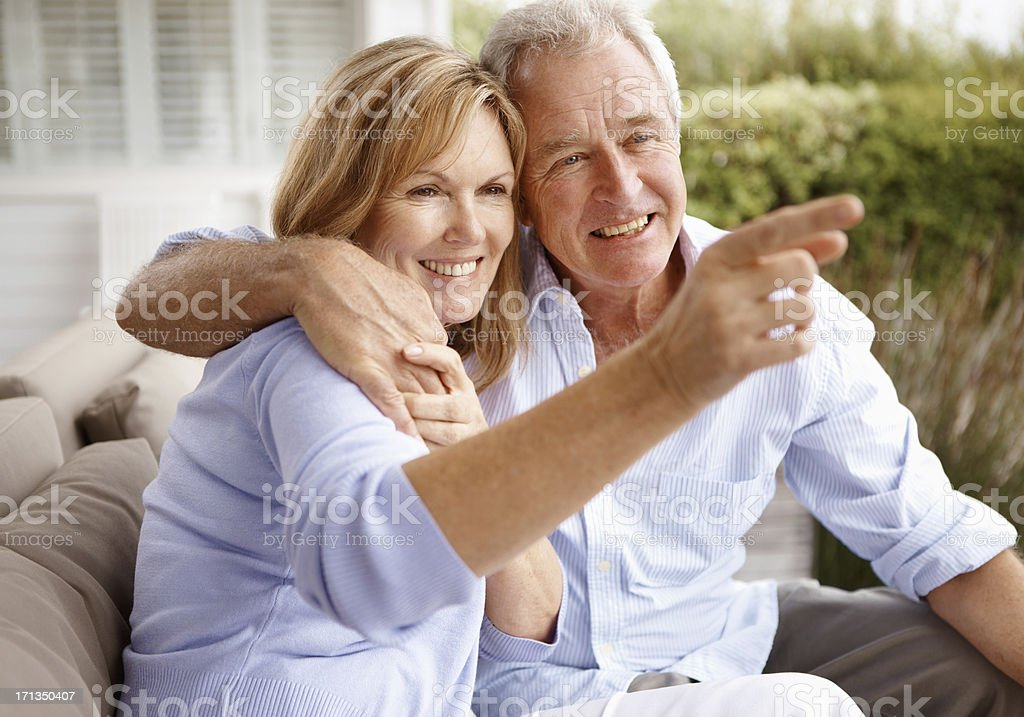 Loving the scenery around their retirement home stock photo