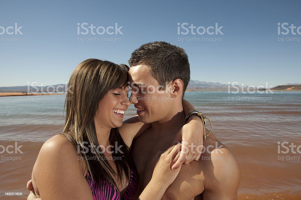 Loving Young Couple at the Beach stock photo