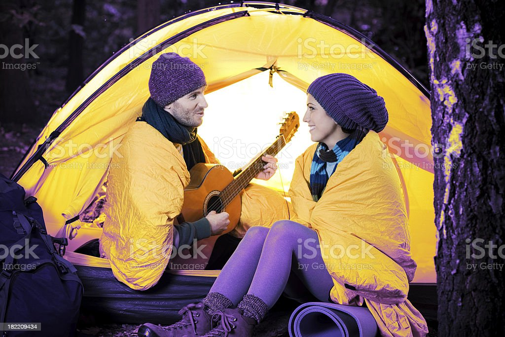 Loving Young Couple Camping royalty-free stock photo