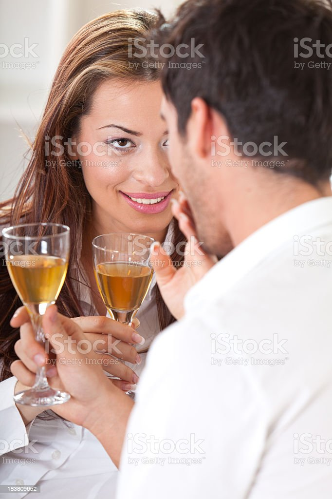 Loving young couple celebrating with champagne royalty-free stock photo