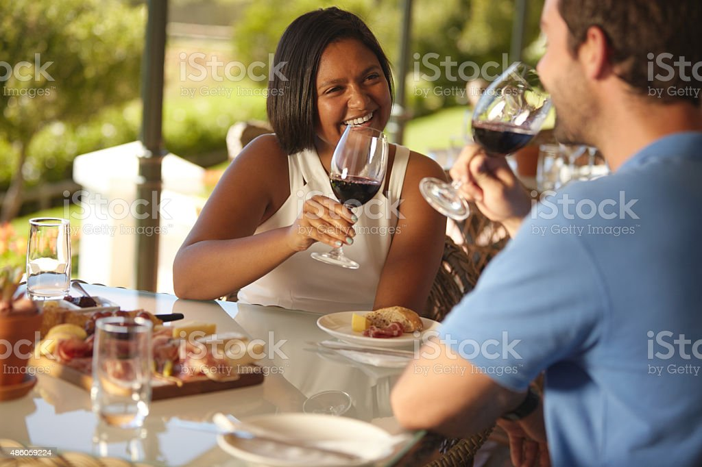 Loving young couple drinking red wine at winery stock photo