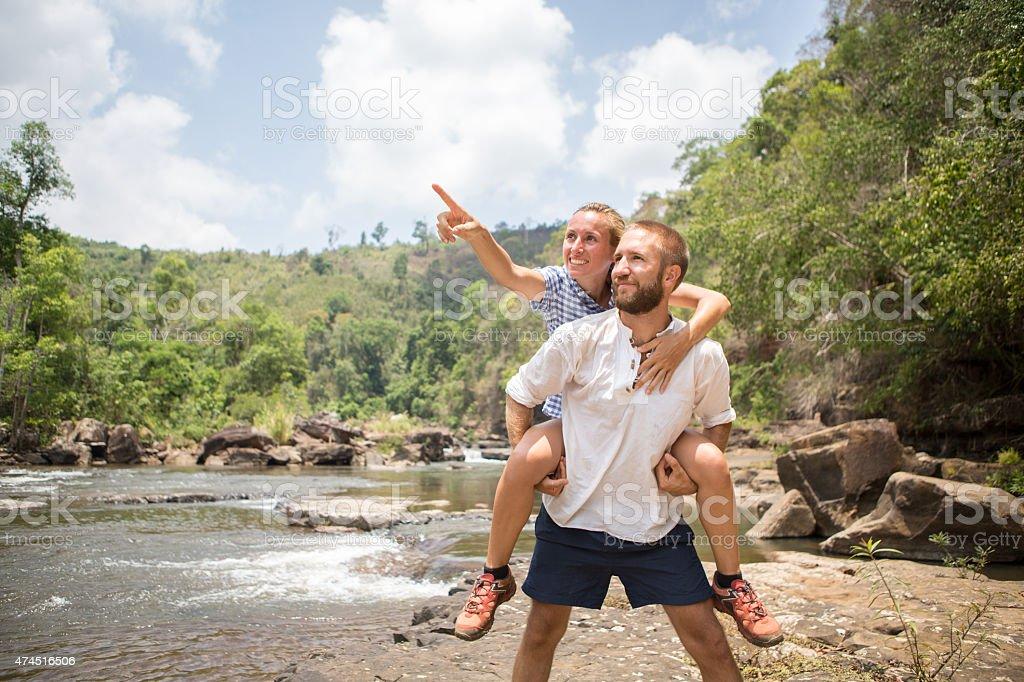 Loving young couple exploring nature-Hiking stock photo