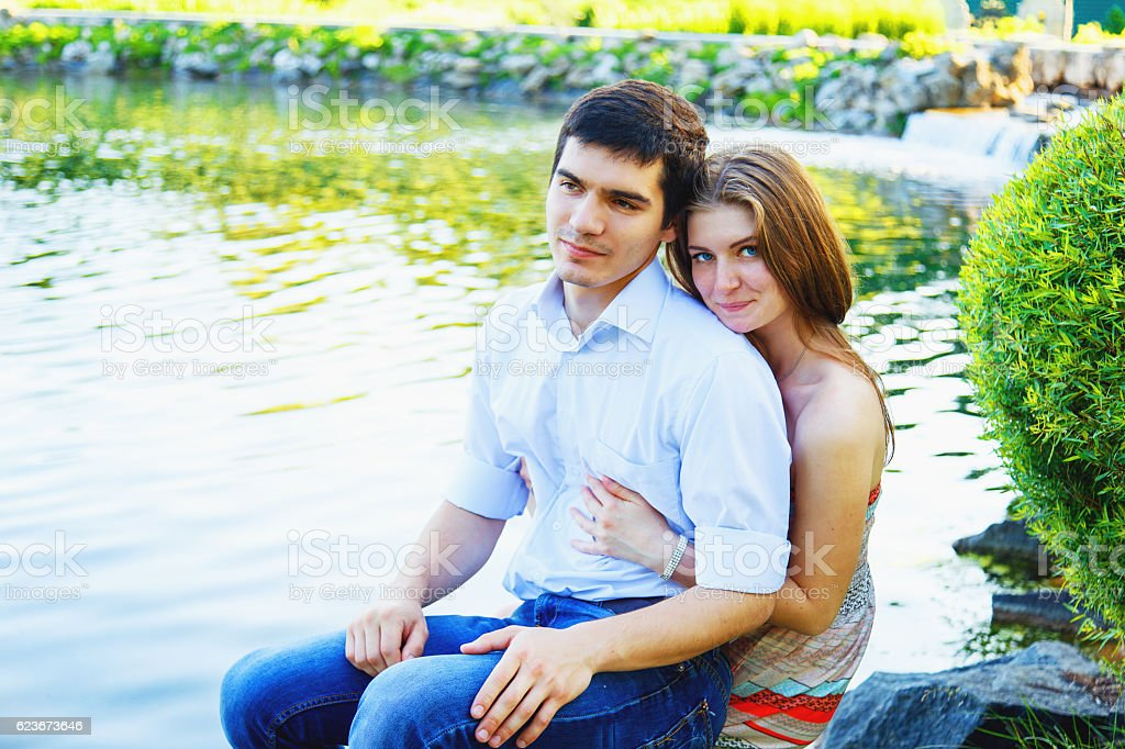 Loving young couple in a park stock photo