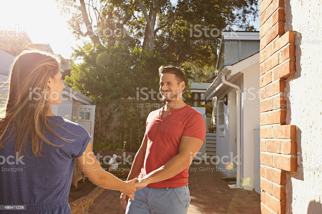 Loving young couple outdoors in their backyard stock photo