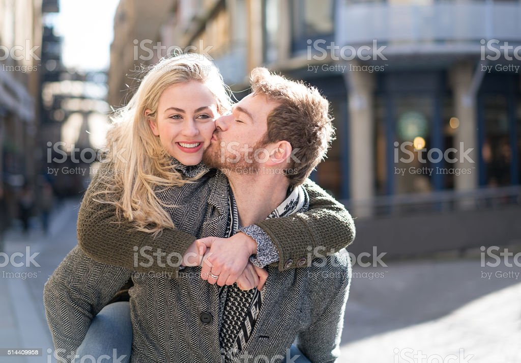 Loving young couple outdoors stock photo