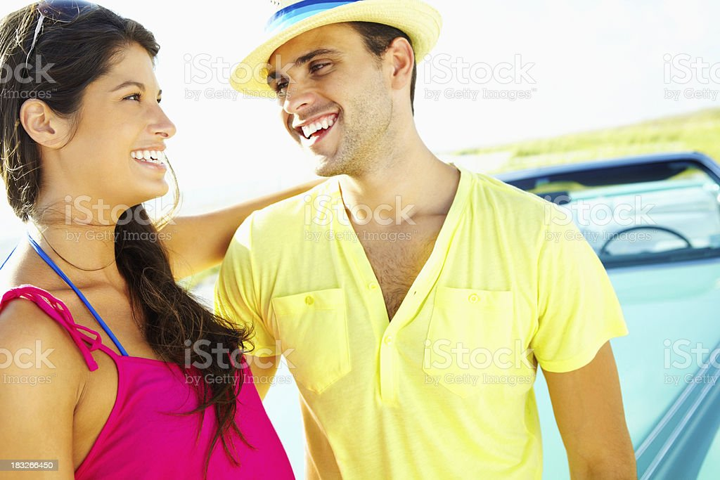 Loving young couple with a car spending time together royalty-free stock photo