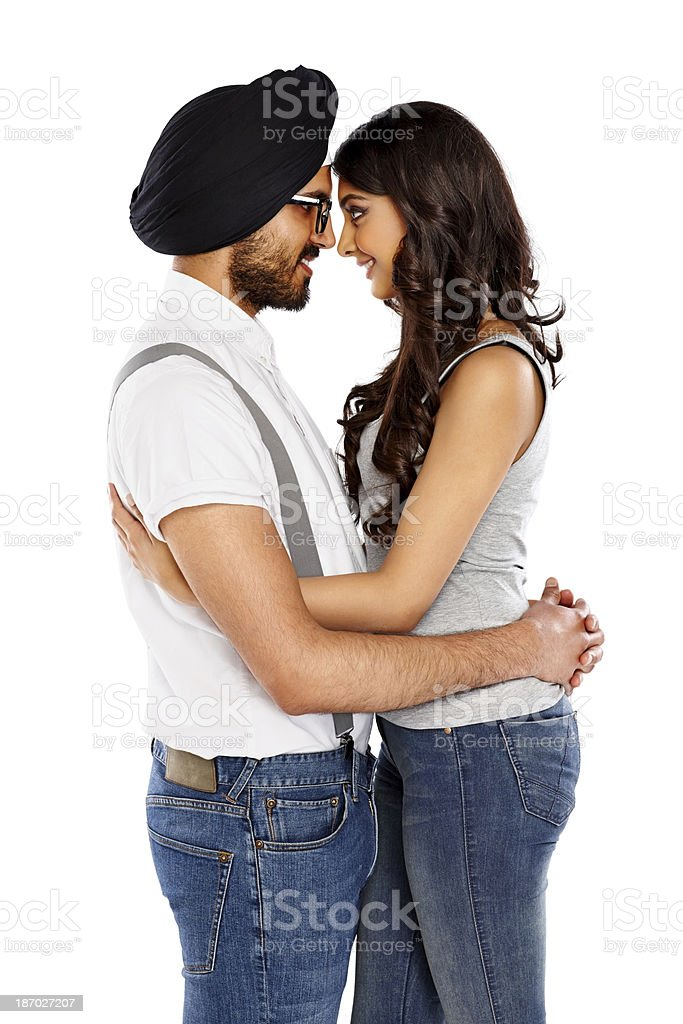 Loving young indian couple hugging royalty-free stock photo