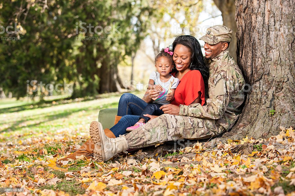 Loving Young Military Family at Park stock photo