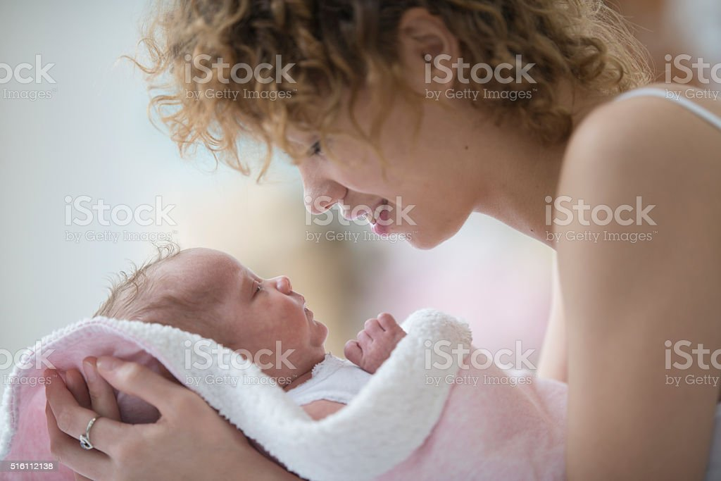 Lovingly Looking At Her Child stock photo