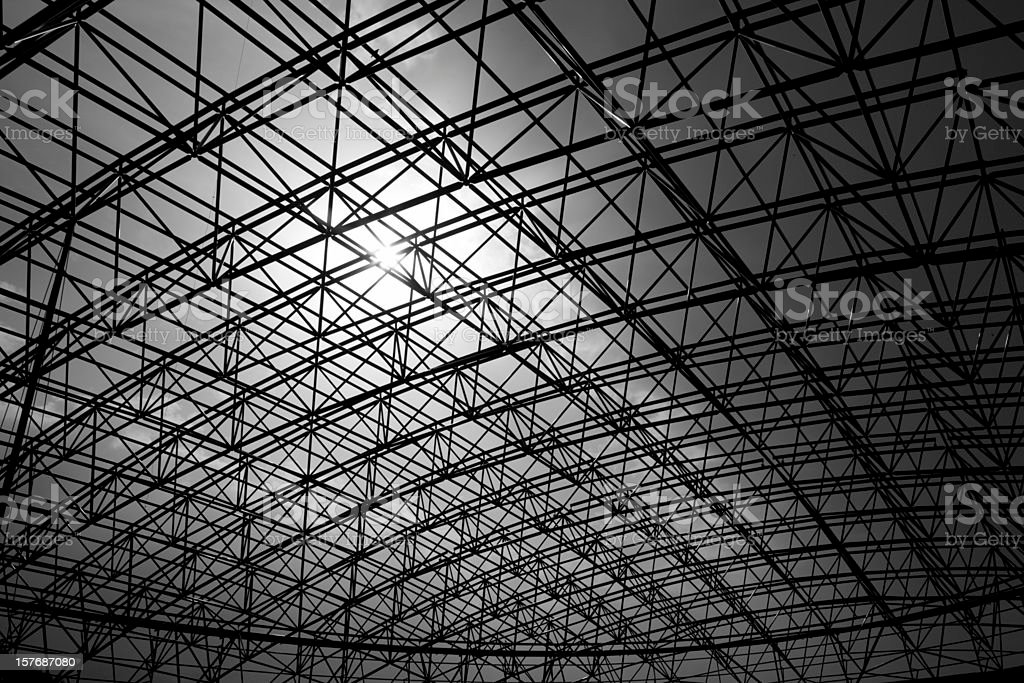 Low angle black and white photo of metal construction royalty-free stock photo