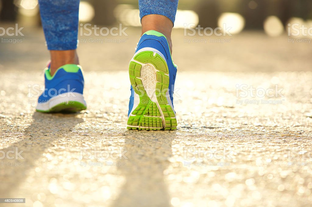 Low angle close up female running shoes stock photo