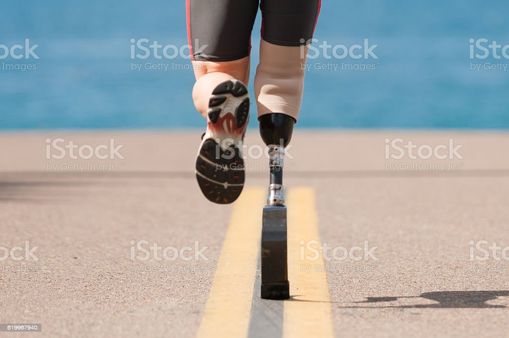 Low Angle Of Prosthetic Leg Running stock photo