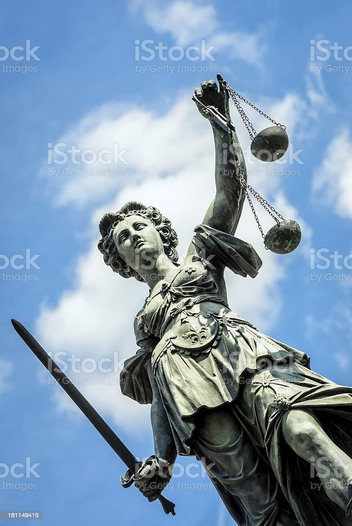 Low angle of view of a statue representing justice under sky stock photo