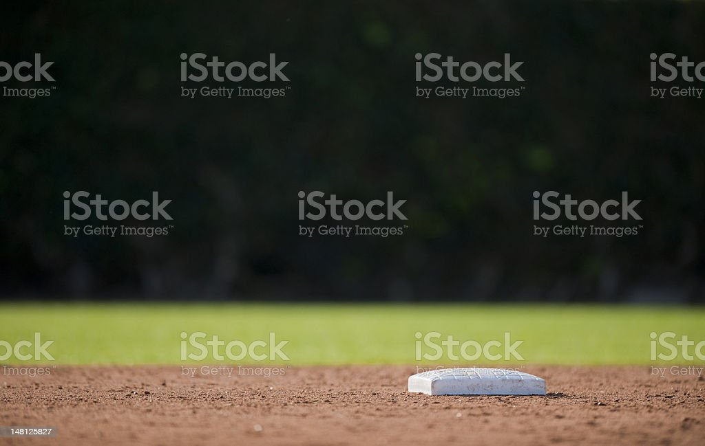 Low angle photo of an empty baseball base stock photo