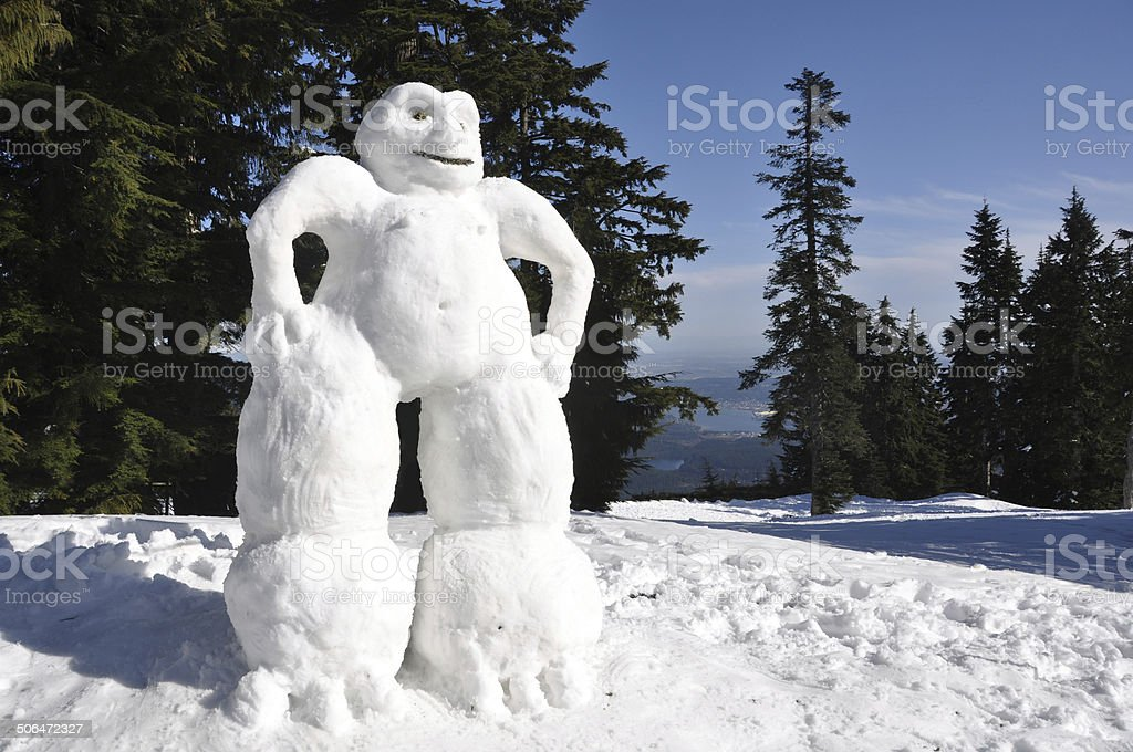 Low angle shot of a big, tall friendly snowman. stock photo