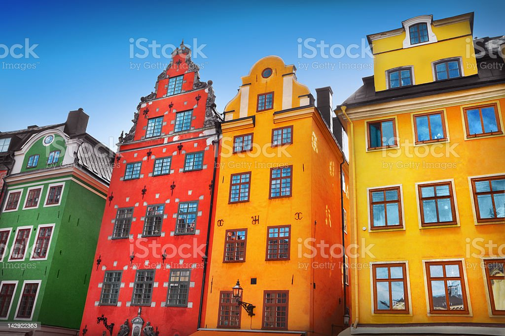 Low angle shot of colorful buildings in old town stock photo