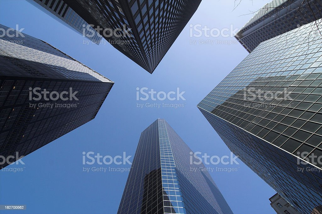 Low angle shot of corporate buildings against blue sky stock photo