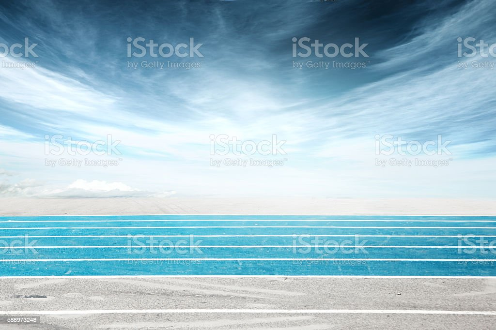 Low angle side shot of a running track, blue stock photo