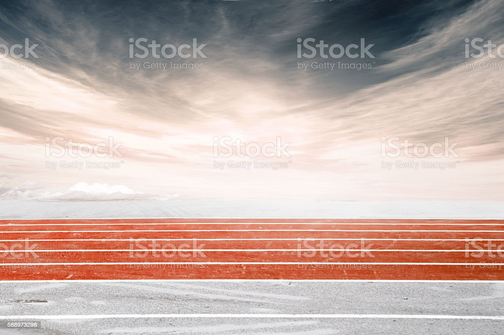 Low angle side shot of a running track, orange stock photo