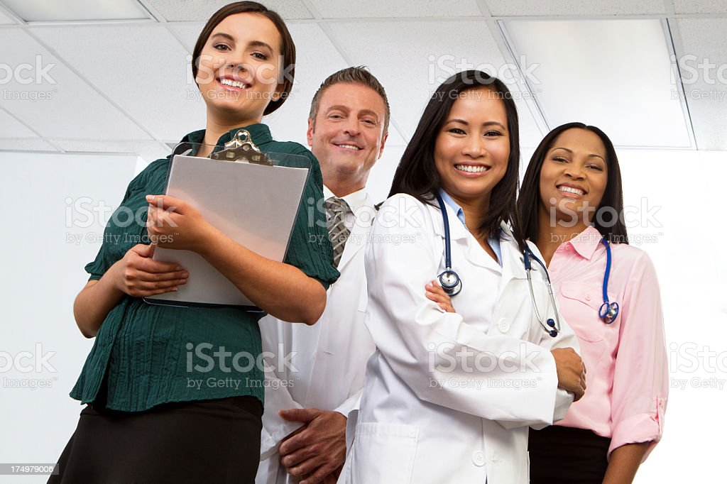 Low angle three women and a man with stethoscopes royalty-free stock photo