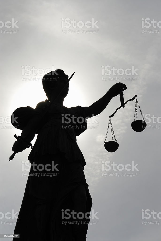 Low angle view of a silhouette of the statue Justitia stock photo