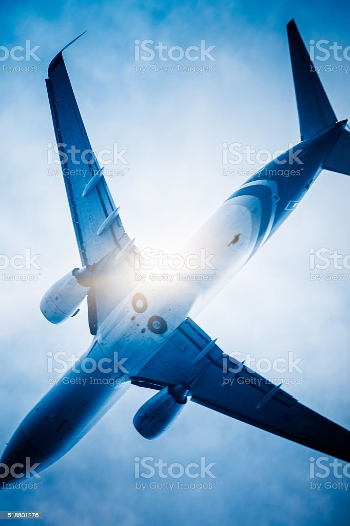 low angle view of airplane flying stock photo