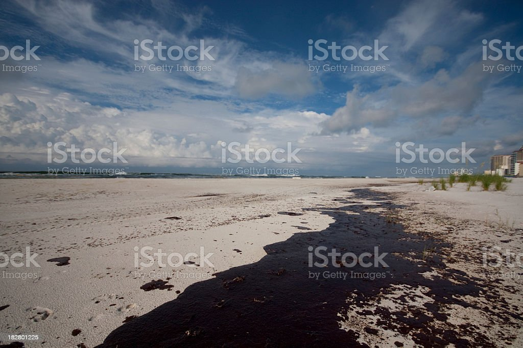 Low angle view of an oil spill on a beach  stock photo