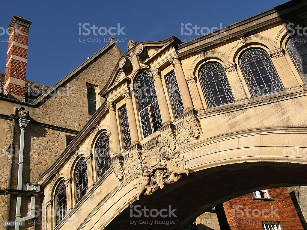 Low angle view of an ornate beige bridge with windows stock photo