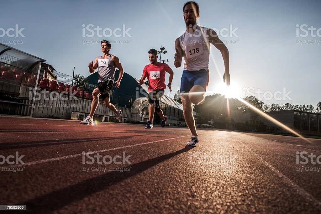Low angle view of athletes having a sports race. stock photo
