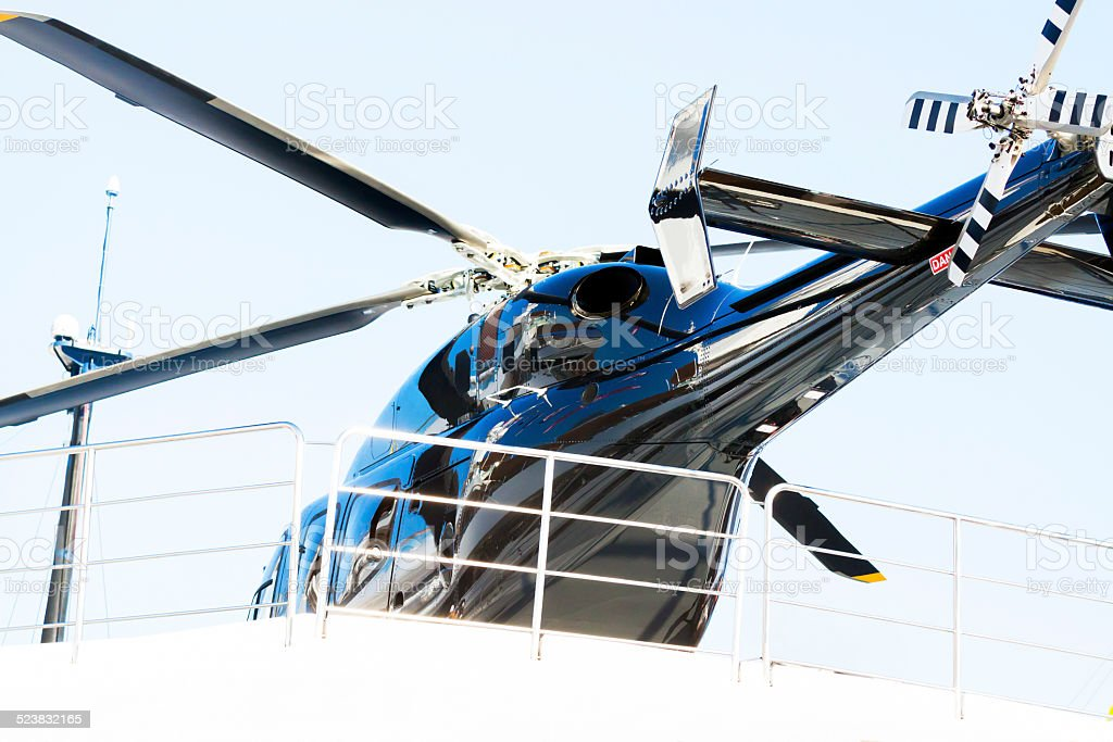 Low angle view of black Helicopter on the yacht stock photo