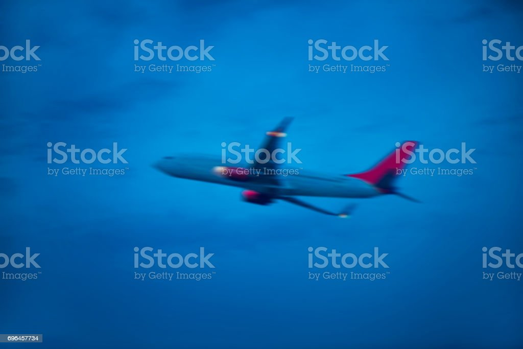 Low angle view of blurred (defocused) airplane moving up fastly stock photo