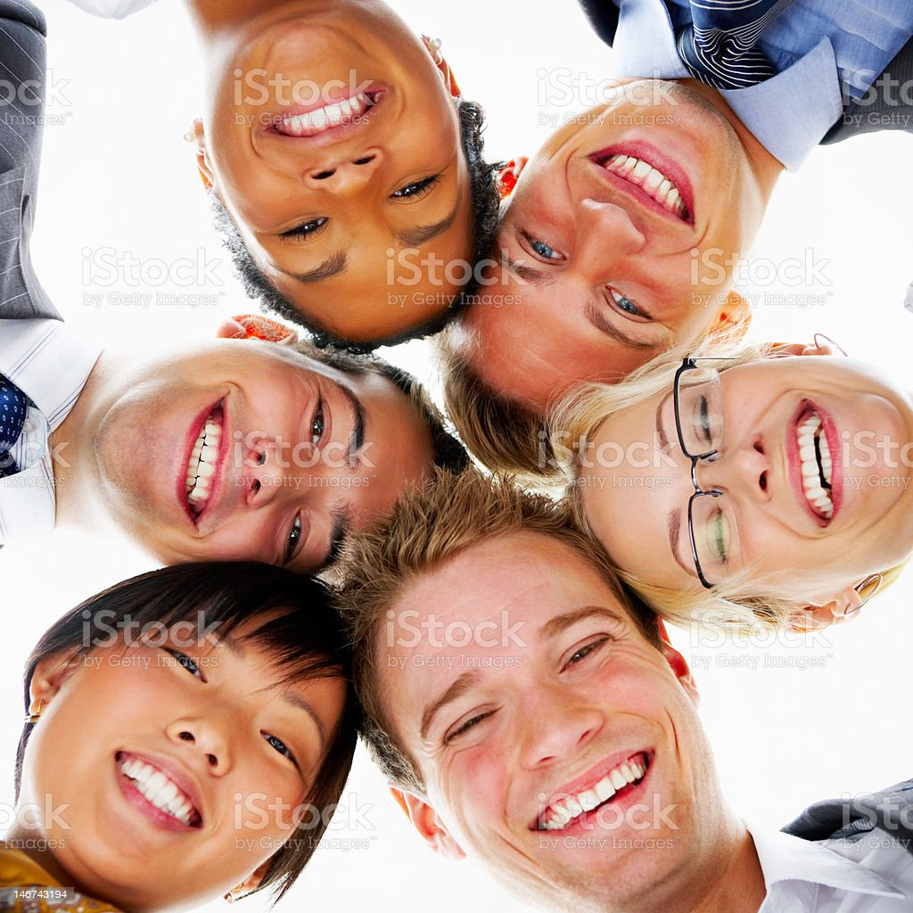 Low angle view of business colleagues smiling together royalty-free stock photo