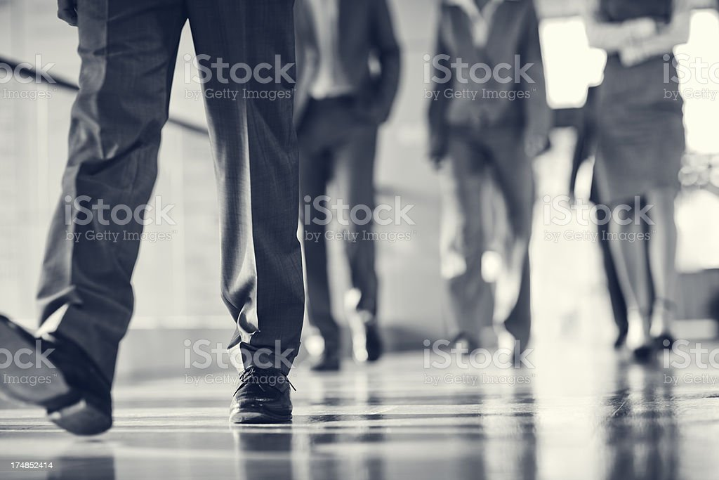 Low angle view of business people walking in lobby stock photo