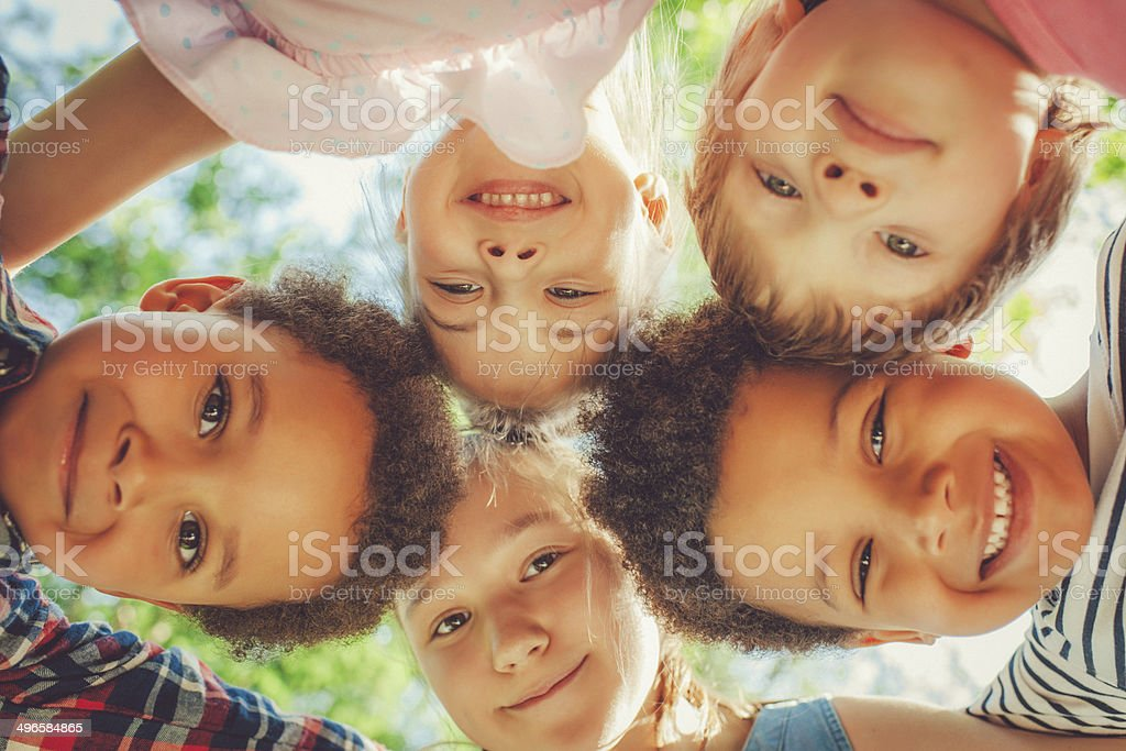 Low angle view of children in a park stock photo