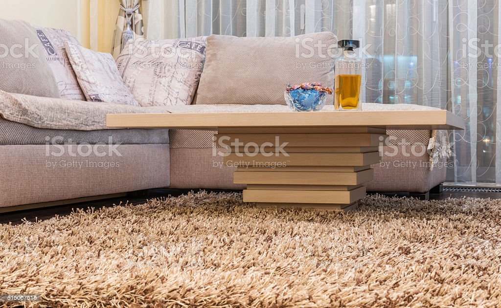 Low angle view of coffee table and white sofa stock photo