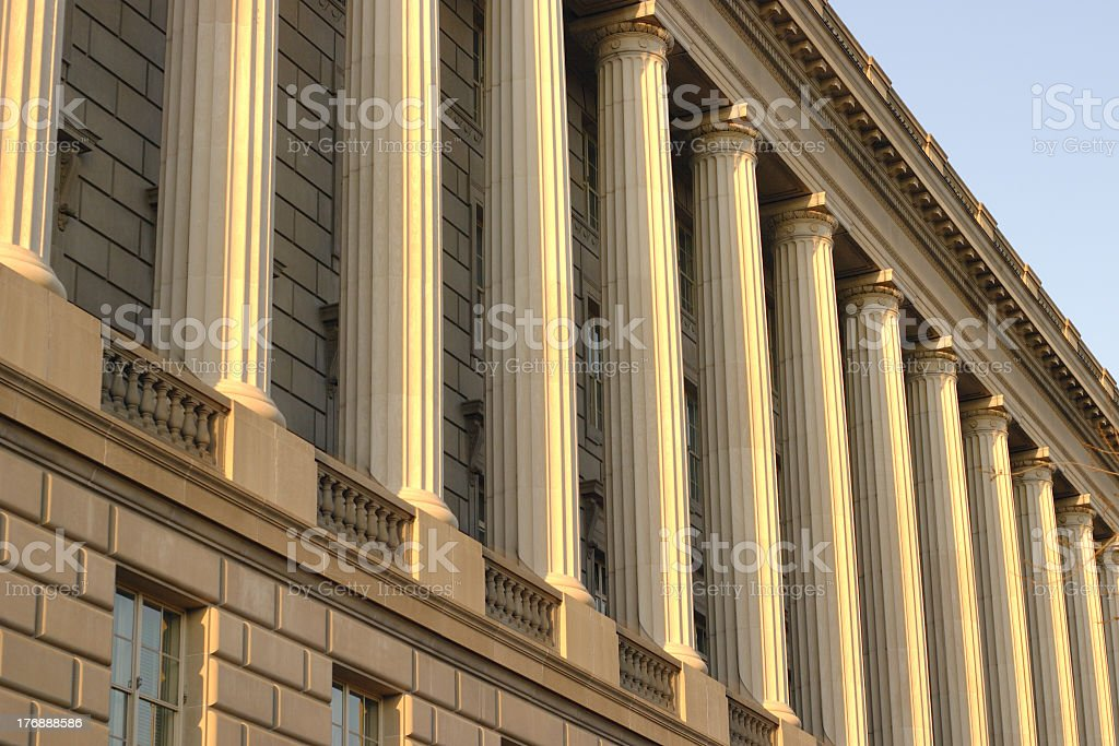 Low angle view of columns on the outside of a building stock photo